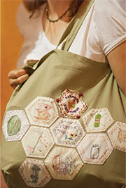 Carrie Meerwarth's bag, chock full of sewn-on merit badges - Merit Badge Awardees