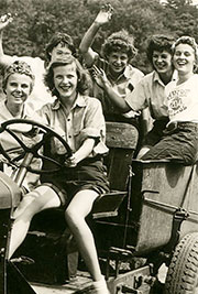 Bunch of farmgirls waving, having fun on a tractor - Official Roster